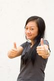 Young woman giving two thumbs up Stock Photos