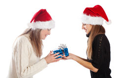 Young woman giving Xmas present to her friend Stock Photos
