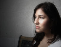 Young woman glancing away. Image of a young female glancing away. Soft focus Stock Images
