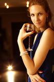 Young woman with glass Royalty Free Stock Images