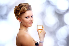 Young woman with a glass of champagne Royalty Free Stock Photos