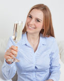 Young woman with a glass of champagne Royalty Free Stock Photography