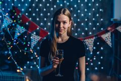 Young woman with glass of champagne. New Year, Christmas royalty free stock photography