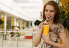 Young woman with a glass of  juice Stock Images