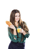 Young woman with glass of juice and croissant. White background isolate Royalty Free Stock Photos
