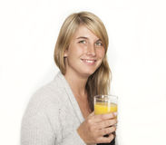 Young woman with glass of juice Stock Photo