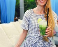 Young woman with glass of lemonade. Outdoors stock photos