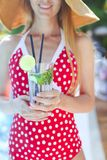 Young woman with glass of lemonade. Outdoors stock image
