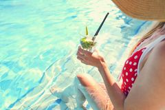 Young woman with glass of lemonade. Near the pool stock images