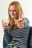 Young woman with a glass of milk, top Stock Photography