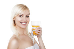 Young woman with glass of orange juice. Female Royalty Free Stock Photography