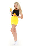 Young woman with glass of orange juice. Stock Photos
