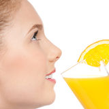 Young woman with glass of orange juice isolated Royalty Free Stock Photos