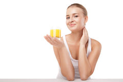 Young woman with a glass of orange juice isolated Stock Photography