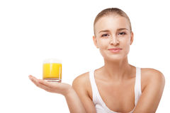 Young woman with a glass of orange juice isolated Stock Photo