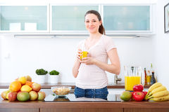 Young woman with a glass of orange Juice Royalty Free Stock Image