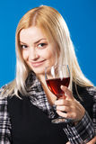 Young woman with a glass of red wine Stock Photography