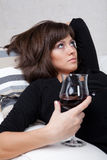 Young woman with a glass of red wine Royalty Free Stock Images