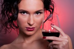 Young woman with glass of red wine Royalty Free Stock Photography