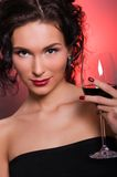 Young woman with glass of red wine Stock Images