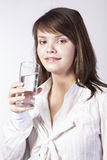 Young woman with glass of water on a white. Young woman with glass of water is on a white background Royalty Free Stock Photo