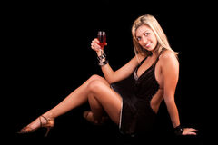 Young woman with glass of wine. On black background Royalty Free Stock Photos