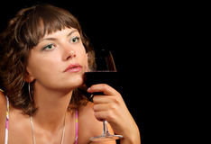 Young woman with a glass of wine Royalty Free Stock Images