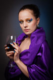 Young woman with glass of wine. Royalty Free Stock Photos