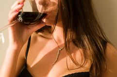 Young woman  with glass of wine Royalty Free Stock Image