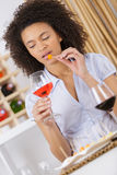Young woman with glass wine and eating Royalty Free Stock Image
