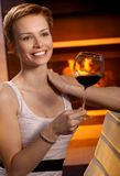 Young woman with glass of wine Stock Photography
