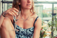 Young woman with glass of wine Stock Photos