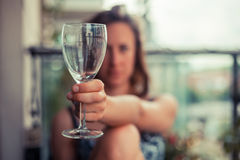 Young woman with glass of wine Stock Image