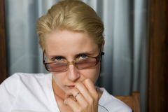 Young woman in glasses Royalty Free Stock Photography