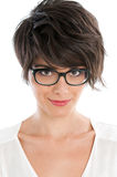 Young woman with glasses. Smiling satisfied beautiful woman looking at camera with her new pair of eyeglasses Royalty Free Stock Images