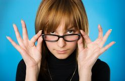 Young woman with glasses. Close-up portrait of young woman looking over her glasses stock photos