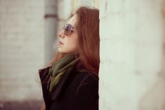 Young woman with glasses against the wall at home Royalty Free Stock Photography