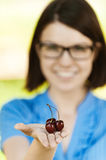 Young woman glasses black cherry Royalty Free Stock Image