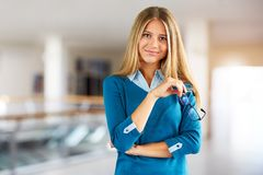 Woman with glasses in a business center on the corridor stock photo