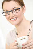 Young Woman in Glasses Drinking Tea or Coffee Stock Image