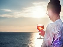 Young woman in glasses with a glass of beautiful, pink cocktail stock image