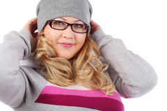 Young woman in glasses and hat looks at camera Stock Image