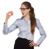 Young woman in glasses holding a chicken egg Royalty Free Stock Images