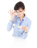 Young woman in glasses keeping dollar bill Royalty Free Stock Image