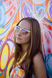 Young woman in glasses near graffiti wall Royalty Free Stock Photo