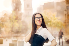 Young Woman with Glasses Out in the City Royalty Free Stock Photo