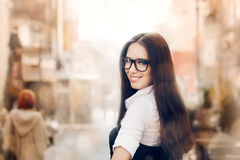 Young Woman with Glasses Out in the City Royalty Free Stock Images