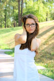 Young woman with glasses outdoor Royalty Free Stock Image