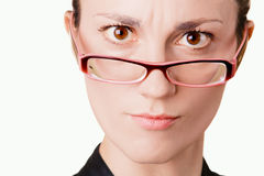 Young woman in glasses portrait. Young angry woman in glasses portrait on white background Stock Photos