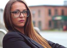 Young businesswoman outside glasses profile portrait Stock Photo